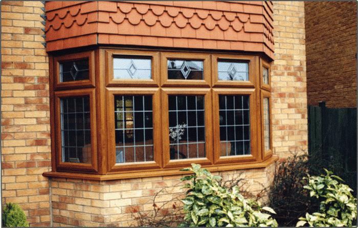 Mẫu cửa nhựa lõi thép vân gỗ tại các cửa sổ